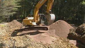 bulldozer digging a turkey mound for a septic system