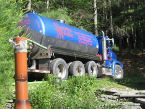 Septic Medic tanker truck driving on a Pennsylvania road.