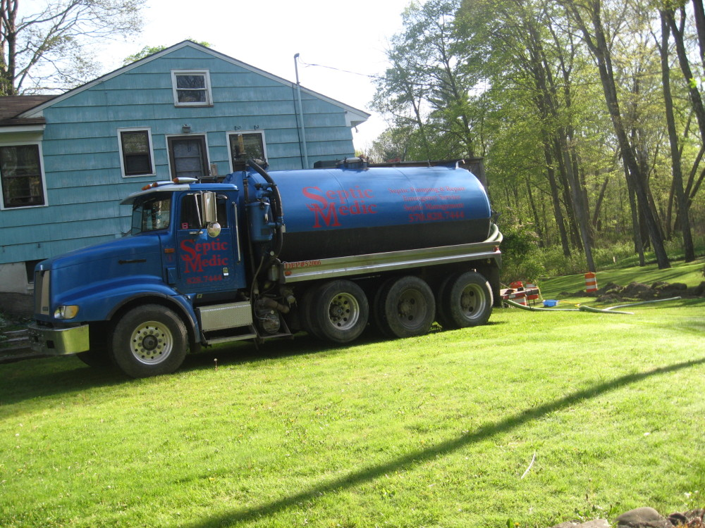 Septic Medic truck parked at a Pennsylvania home to perform septic tank maintenance